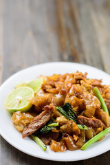 Thai food, stir fried rice noodles in soy sauce (Pad See Ew)