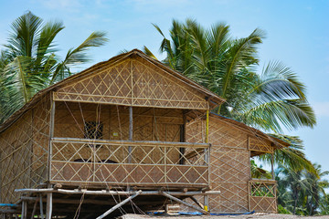 Wooden house made of bamboo in the village of Mandrem in Northern Goa.India