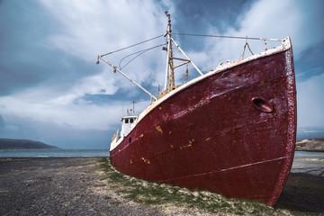 Dramatic sky over old shipwreck in Patreksfjordur, Westfjords, Iceland