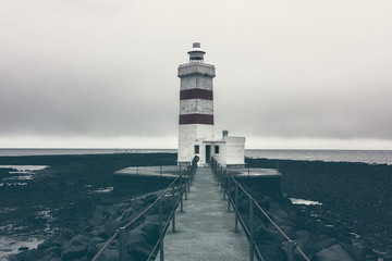 Gardur Lighthouse on a cloudy day in on the southern peninsula in southwest Iceland