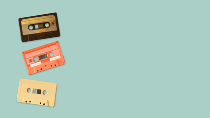 Tape cassette recorder on color background. retro technology. flat lay, top view hero header. vintage color styles.
