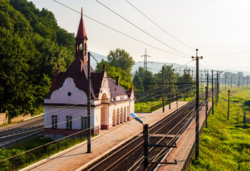 old railway station at sunrise. beautiful scenery in mountains. location Karpaty, TransCarpathia, Ukraine.