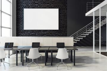 Coworking interior with empty billboard