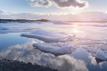 Frozen Jokulsarlon glacier lagoon, winter season natural landscape background
