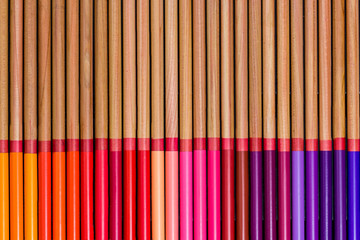 Double row of mulicolored pencils