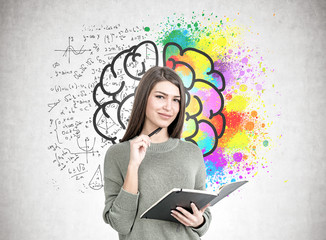 Smiling woman with a planner, brain
