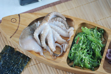 salad from sea kale cabbage, octopus
