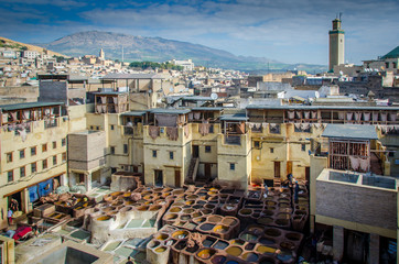 FEZ, MOROCCO - Februari 25, 2018: Making leather and painting leather in Fez. And a nice view over the city
