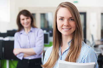 Portrait Of Young Businesswoman With Mentor In Office