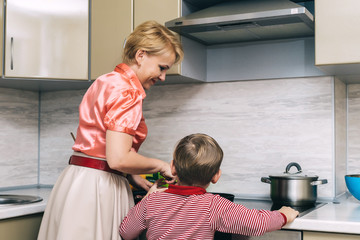 Middle aged woman and her son cooking together