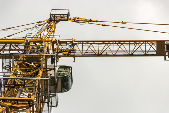 Tower crane against the blue sky, close up, details