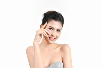 The concept of healthy beautiful woman. Beautiful women keep healthy. Beautiful women take care of skin health. Beautiful women are thinking about beauty. Beautiful Asian girl is pointing fingers.