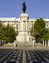 New Square (Plaza Nueva) and monument of Fernando III The Saint (Fernando III El Santo) in Seville, Spain.