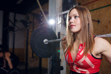 Photo of sports woman engaged with bar