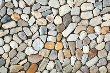 The walls are decorated with small stones for the background.