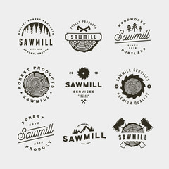 set of sawmill logos. retro styled woodwork emblems. vector illustration