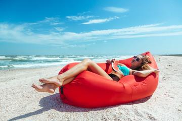 Girl relaxing on lamzac on the beach