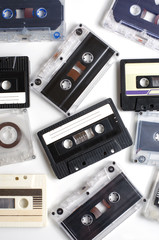 Old audio cassettes on white background. Flat top view