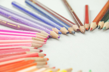 wooden colored pencils on white texture