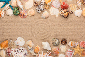 Circle made of sand, frame of seashells and stars. With space for the designer.