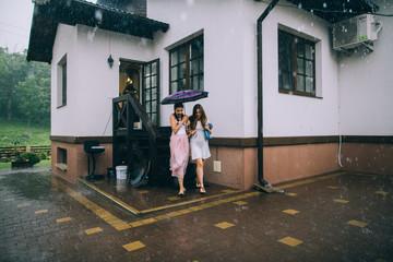 Girls running from the rain