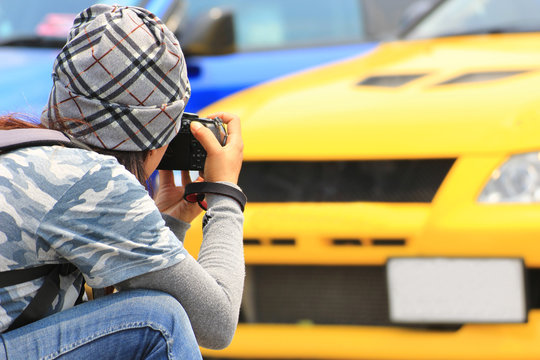 Photographer taking picture of the car