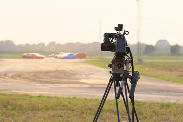 Video camera operator working at the race track
