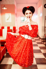 Pretty pin-up woman with make-up, vintage style