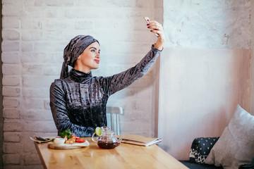 young beautiful woman taking selfie using smartphone