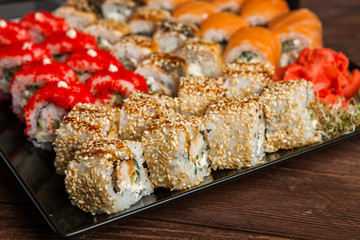 Best Types of Sushi Rolls. Philadelphia Roll, California Roll, Eel Avocado Roll. Delicious rolls and sushi with eel, salmon, shrimp, cucumber and philadelphia. Various delicious Types of Sushi Rolls