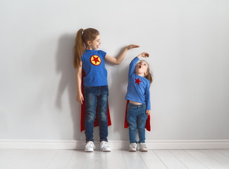children are playing superhero