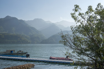 Landscape of famous attraction lake at Taiwan, with boats on dock at sunny day.