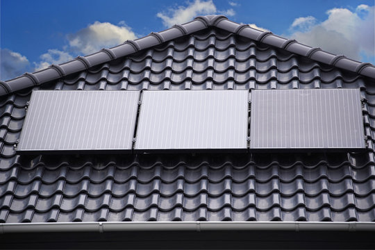 Modern house roof with solar panel system for energy saving