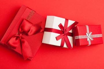 Red and white gift boxes on red background