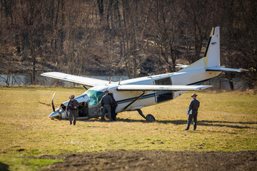 Crashed plane on field with police investigating