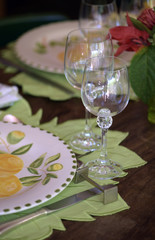 Close-up of decorated for special event table with colorful crockery dish