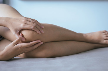Young asian woman having a knee pain,Female feeling exhausted and painful,Concept for health