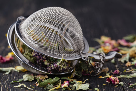 Heap of medicinal herbs for tea on wooden table