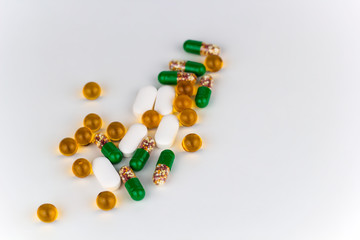 pills and vitamins mess white background copy space