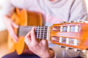 woman playing spanish guitar