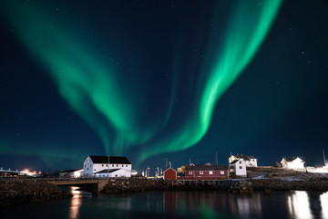 Northern light shining in the sky with village foreground in Lofoten,Norway