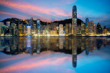 Fototapete - Hong Kong City skyline at sunrise. View from across Victoria Harbor Hongkong.