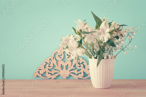 Summer Bouquet Of White Flowers In The Vase Over Wooden Table And