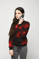 Young brunette teen girl talking on the phone