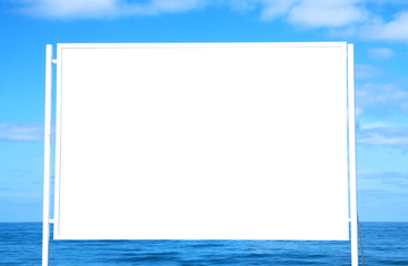 Image of empty white billboard on the beach infront of blue sea and the sky. For mockup and advertisement.