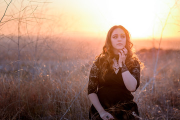 Brunette Female wearing lace dress in field