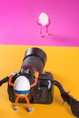 Egg photographer taking shot of model on a background