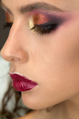 Woman with eye makeup and purple lips, beauty. Woman with young skin face, skincare and youth. Beauty model with glamour look and makeup. Skincare, cosmetics and visage. Fashion girl trend and style.
