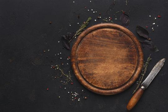 Wooden cutting board on dark background