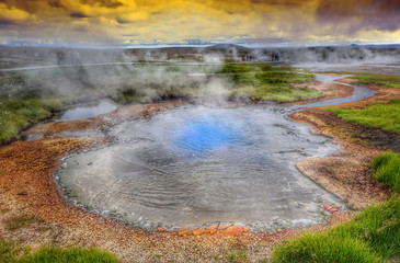 Hot steam over the source of the thermal waters, Hveravellir, Iceland. White nights in Iceland.